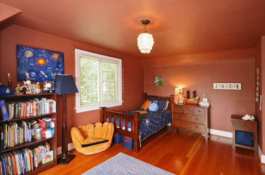 Bedroom of 2426 10th Ave. W. The 2,640-square-foot house, built in 1928, has four bedrooms, 2.5 bathrooms, a family room, leaded glass, wood and tile floors, a deck and a patio on a 4,000-square-foot lot. It's listed for $775,000. Photo: Dan Farmer, Courtesy Sam Konswa, Queen Anne Real Estate