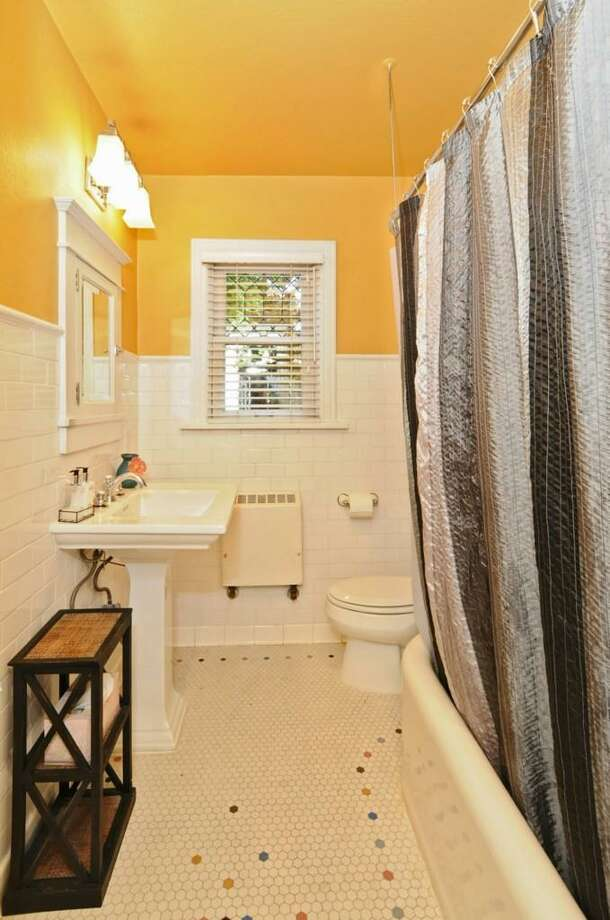 Bathroom of 2426 10th Ave. W. The 2,640-square-foot house, built in 1928, has four bedrooms, 2.5 bathrooms, a family room, leaded glass, wood and tile floors, a deck and a patio on a 4,000-square-foot lot. It's listed for $775,000. Photo: Dan Farmer, Courtesy Sam Konswa, Queen Anne Real Estate