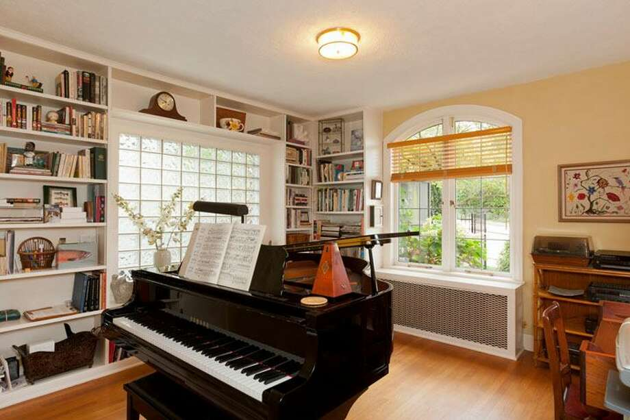 Library of 2556 1st Ave. N. The 3,000-square-foot brick house, built in 1926, has three bedrooms, 1.75 bathrooms, a den, a family room, vaulted ceilings, leaded glass, a balcony, a deck and a two-car garage on a 5,298-square-foot lot. It's listed for $795,000. Photo: Courtesy Stephen Hicks, Windermere Real Estate