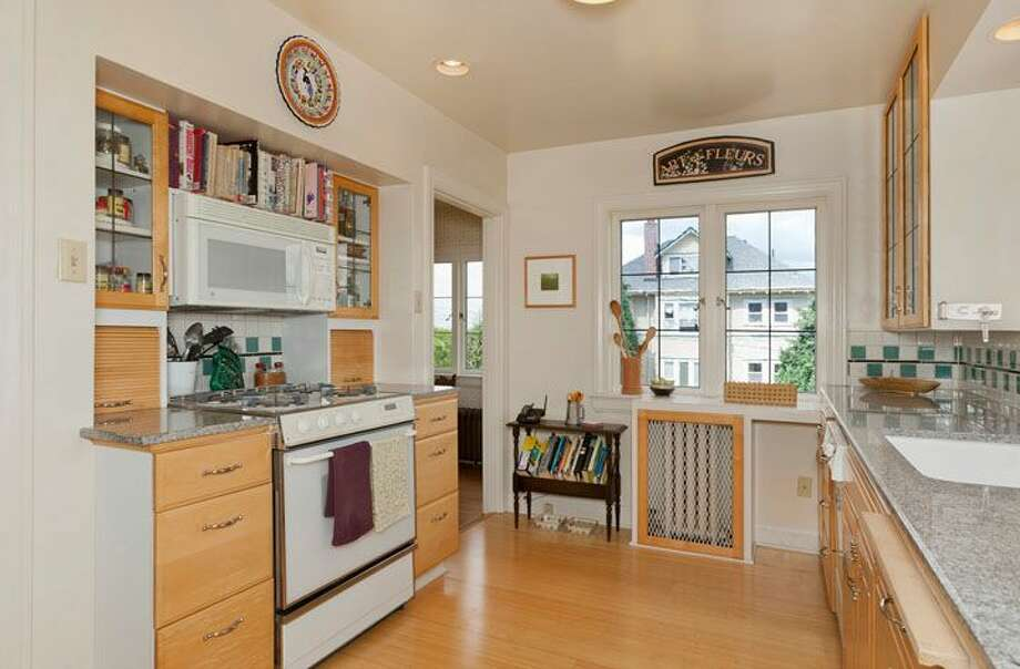 Kitchen of 2556 1st Ave. N. The 3,000-square-foot brick house, built in 1926, has three bedrooms, 1.75 bathrooms, a den, a library, a family room, vaulted ceilings, leaded glass, a balcony, a deck and a two-car garage on a 5,298-square-foot lot. It's listed for $795,000. Photo: Courtesy Stephen Hicks, Windermere Real Estate