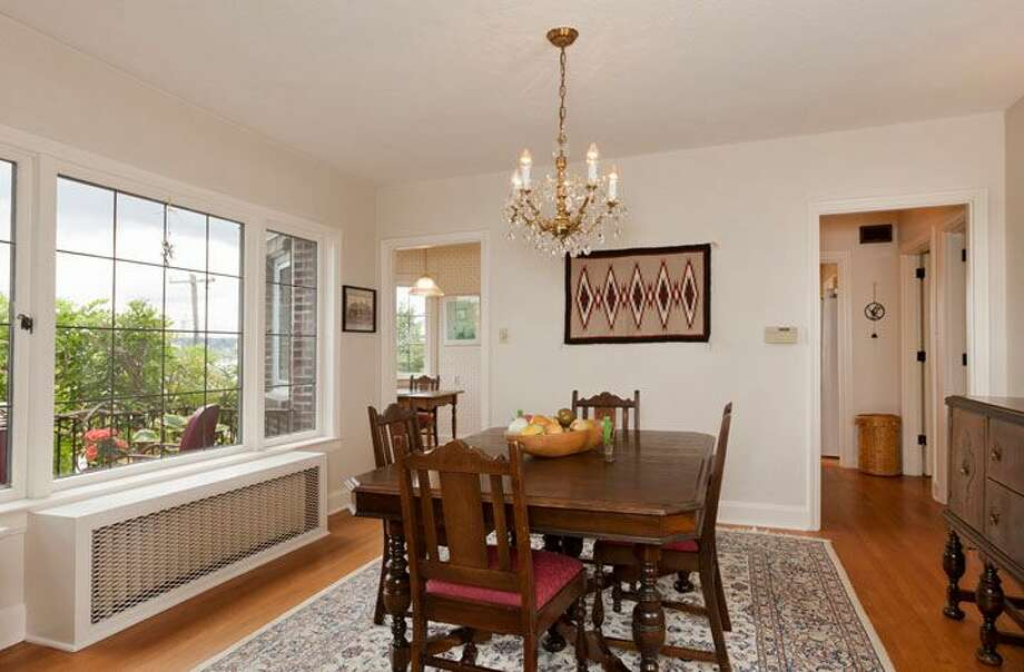 Dining room of 2556 1st Ave. N. The 3,000-square-foot brick house, built in 1926, has three bedrooms, 1.75 bathrooms, a den, a library, a family room, vaulted ceilings, leaded glass, a balcony, a deck and a two-car garage on a 5,298-square-foot lot. It's listed for $795,000. Photo: Courtesy Stephen Hicks, Windermere Real Estate