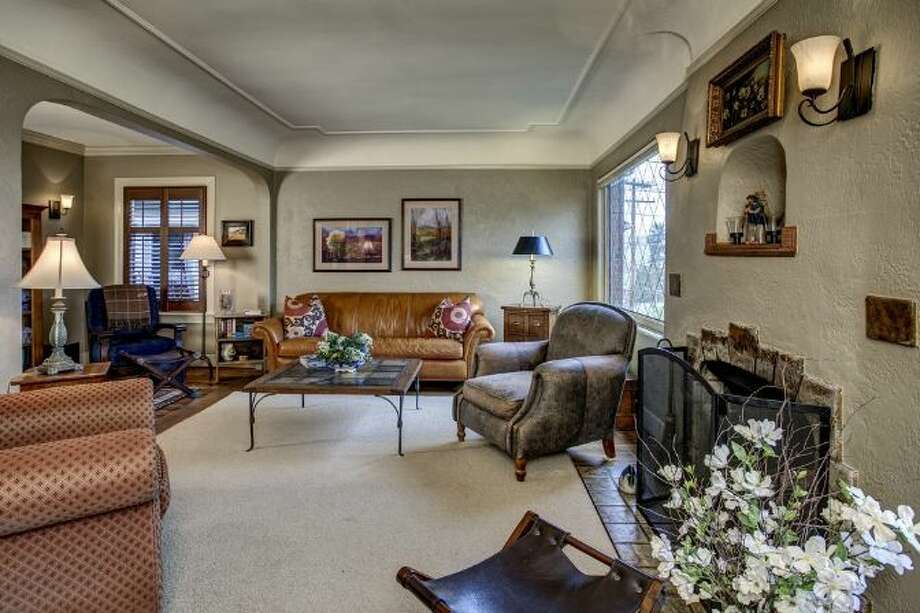 Living room of 2721 Warren Ave. N. The 2,730-square-foot brick house, built in 1929, has three bedrooms, 1.75 bathrooms, coved ceilings, wood and tile floors, and a bluestone patio with an arbor on a 4,000-square-foot lot. It's listed for $799,000. Photo: Courtesy Bonnie Sanborn, Windermere Real Estate