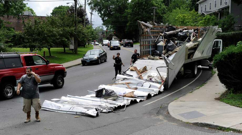 A moving truck too tall to make it under the West Street bridge had its top completely severed Tuesday afternnoon, July 2, 2013, in Danbury, Conn. Photo: Carol Kaliff / The News-Times