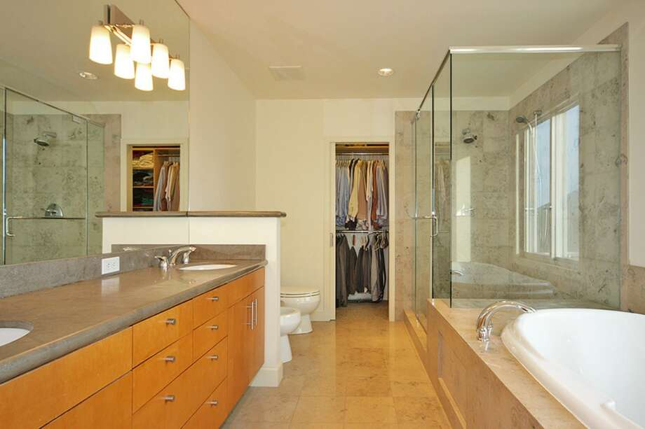 Bathroom of 3447 11th Ave. The 1,850-square-foot house, built in 2002, has three bedrooms, 2.5 bathrooms, a rec room, two gas fireplaces, a three-car garage with shop space and a roof deck. It's listed for $779,900. Photo: Courtesy Cullen Brain, Coldwell Banker Bain