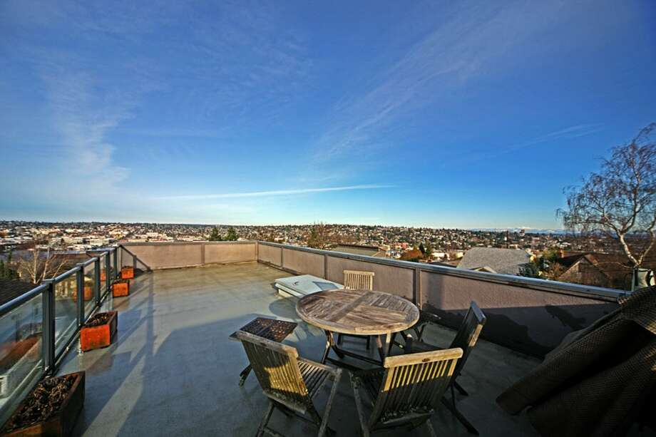 Roof deck of 3447 11th Ave. The 1,850-square-foot house, built in 2002, has three bedrooms, 2.5 bathrooms, a rec room, two gas fireplaces and a three-car garage with shop space. It's listed for $779,900. Photo: Courtesy Cullen Brain, Coldwell Banker Bain