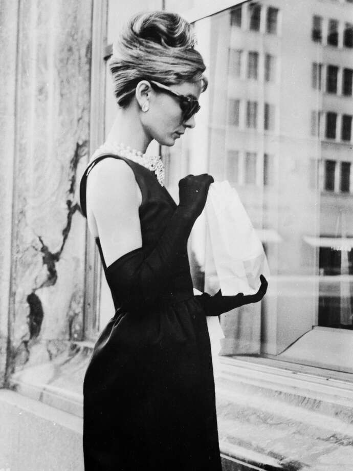 June 1961:  Audrey Hepburn (1929 - 1993) stops for lunch on Fifth Avenue in New York during location filming for 'Breakfast At Tiffany's', directed by Blake Edwards in which she stars as Holly Golightly.  (Photo by Keystone Features/Getty Images)