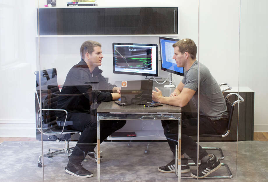 Tyler (left) and Cameron Winklevoss, twins best known for their part in Facebook, are working on a regulated bitcoin exchange. Leeft: The digital currency has seen a number of scandals, including, the collapse of Tokyo exchange Mt. Gox last year. Photo: AGATON STROM / New York Times / NYTNS