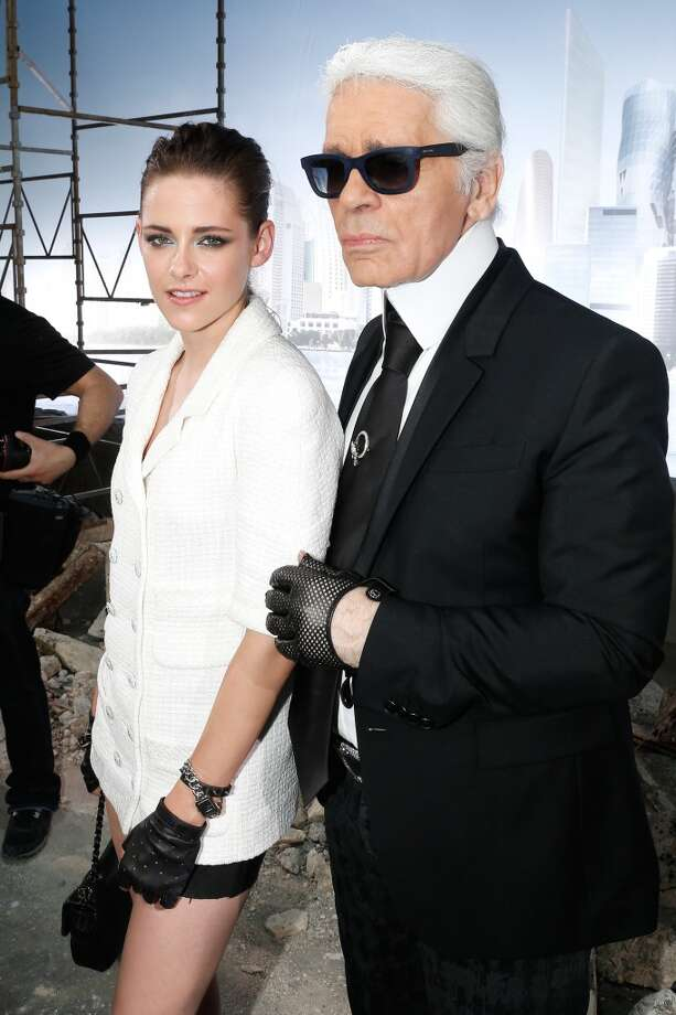 PARIS, FRANCE - JULY 02:  Actress Kristen Stewart (L) and fashion Designer Karl Lagerfeld after the Chanel show as part of Paris Fashion Week Haute-Couture Fall/Winter 2013-2014 at Grand Palais on July 2, 2013 in Paris, France.  (Photo by Bertrand Rindoff Petroff/Getty Images)