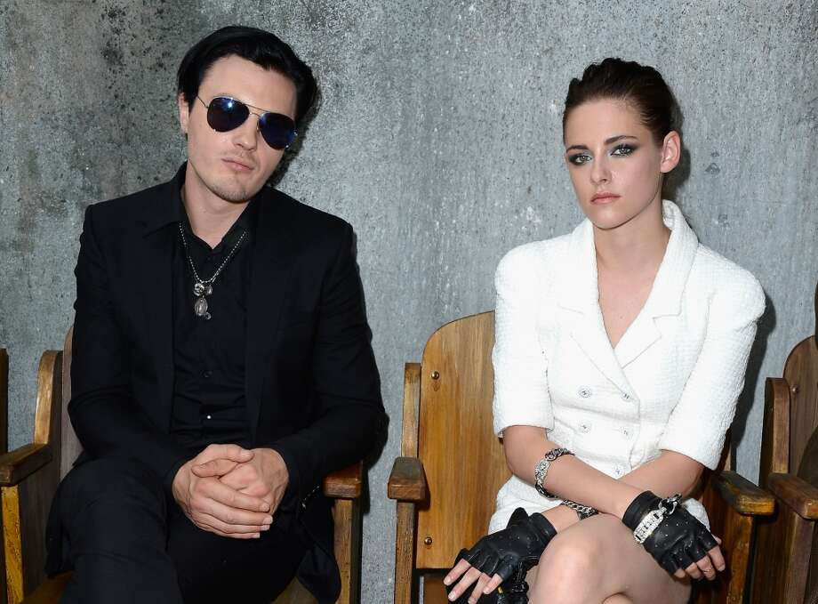 PARIS, FRANCE - JULY 02:  (L-R)  Michael Pitt and Kristen Stewart attend the Chanel show as part of Paris Fashion Week Haute-Couture Fall/Winter 2013-2014 at Grand Palais on July 2, 2013 in Paris, France.  (Photo by Pascal Le Segretain/Getty Images)