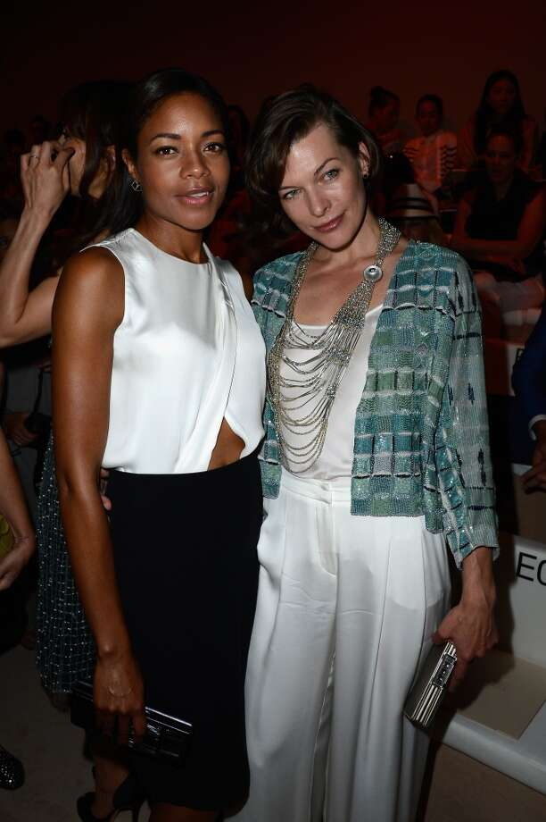 PARIS, FRANCE - JULY 02:  (L-R) Naomie Harris and Milla Jovovich attend the Giorgio Armani Prive show as part of Paris Fashion Week Haute-Couture Fall/Winter 2013-2014 at Theatre National de Chaillot on July 2, 2013 in Paris, France.  (Photo by Pascal Le Segretain/Getty Images)