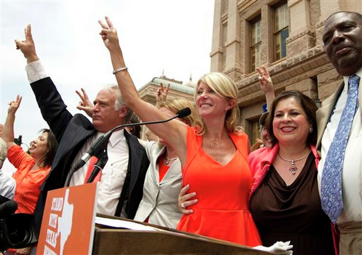 Democrat state senators, from left, Kirk Watson, Wendy Davis, Leticia Van de Putte and Royce West participate in a pro-abortion rights rally at the state Capitol in Austin, Texas, on Monday July 1, 2013.