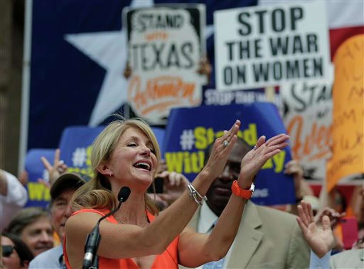Sen. Wendy Davis, D- Fort Worth, speaks during a rally against abortion legislation, Monday, July 1, 2013, in Austin, Texas. The Texas Senate has convened for a new 30-day special session to take up contentious abortion restrictions bill and other issues. (AP Photo/Eric Gay)