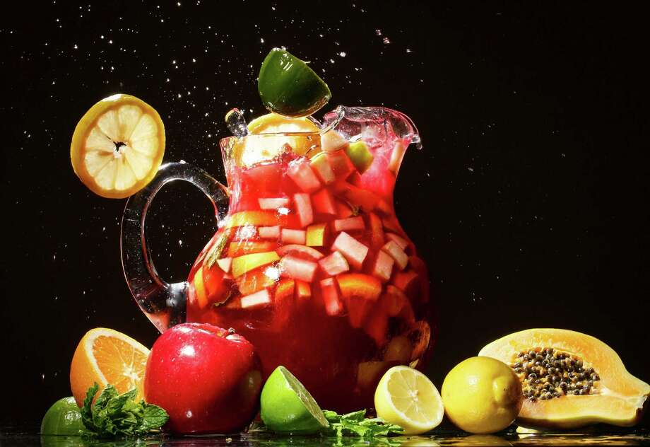 Whether crisp and light or spicy and complex, sangria can encompass a world of flavors. It requires only a wine base, fresh fruit and a bit of liquor. Photo: Michael Paulsen, Staff / © 2013 Houston Chronicle