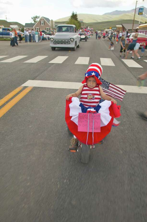 2004 -- This girl is flying her colors in the Independence Day parade in Lima, Mont. Photo: Joe Sohm, Getty Images / © 2004 VisionsofAmerica.com/Joe Sohm.  All Rights Reserved. (800) SOHM-USA (764-6872)