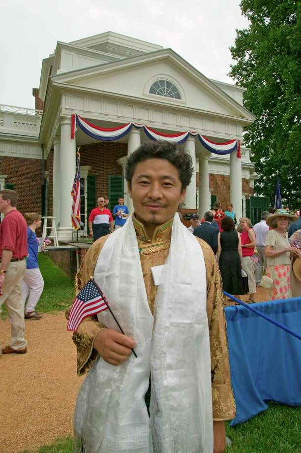 2005 -- A Tibetan immigrant is pictured at an Independence Day naturalization ceremony. Photo: Joe Sohm, Getty Images / © 2003 VisionsofAmerica.com/Joe Sohm.  All Rights Reserved. (800) SOHM-USA (764-6872)