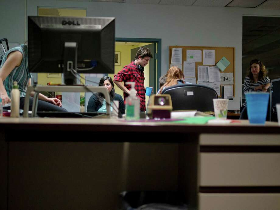 "Director Jesse Zwick, center, talks with crew members for the film ""Seven years and three days,"" as they filmed in the Times Union newsroom on Sunday, June 30, 2013, in Colonie, N.Y. (Paul Buckowski / Times Union) Photo: Paul Buckowski / 00023002A"