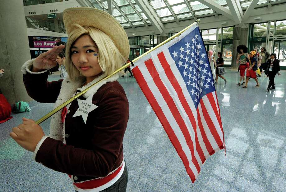 2010 -- Patriotic anime fan reports for duty. Photo: MARK RALSTON, Getty Images / 2010 AFP