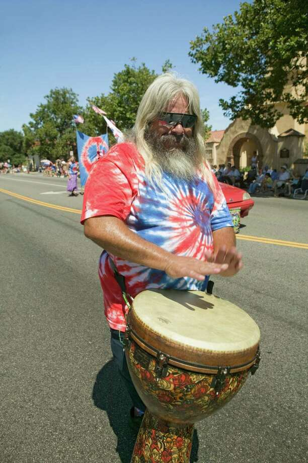 "2006 -- Here's the actual caption to this photo: ""Hippie in red, white and blue tie-dye T-shirt pounds his drum."" Photo: Joe Sohm, Getty Images / Joe Sohm"