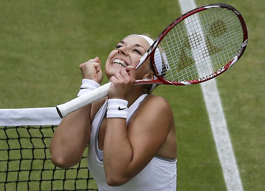 First she beats Serena, now she's in the semis: No wonder Sabine Lisicki of Germany is so happy after defeating Kaia Kanepi at Wimbledon. Photo: Anja Niedringhaus, Associated Press