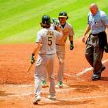 April 7: Athletics 9, Astros 3 Lucas Harrell gave up three home runs, including this solo shot by Coco Crisp in the team's fifth straight loss. Record: 1-5.