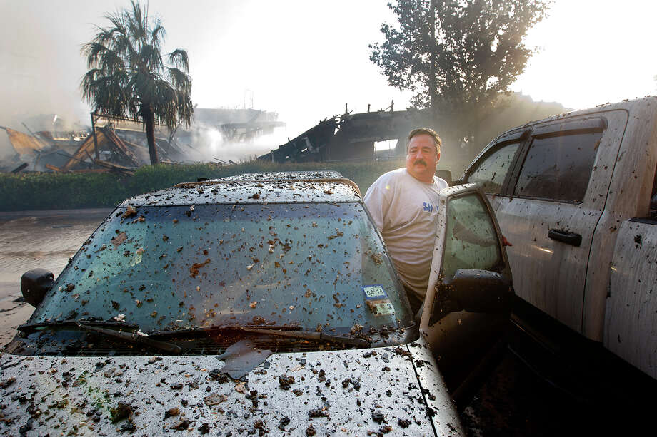 Jimmy Guckian get in his ash-covered truck as firefighters battle a 4-alarm blaze that started in a motel under construction next door along Hempstead Highway near FM 1960, Tuesday, July 2, 2013, in Houston. The fire broke out in the unfinished building about 3 a.m. Firefighters evacuated the neighboring motel with no report of injuries. Photo: Cody Duty, Houston Chronicle / © 2013 Houston Chronicle