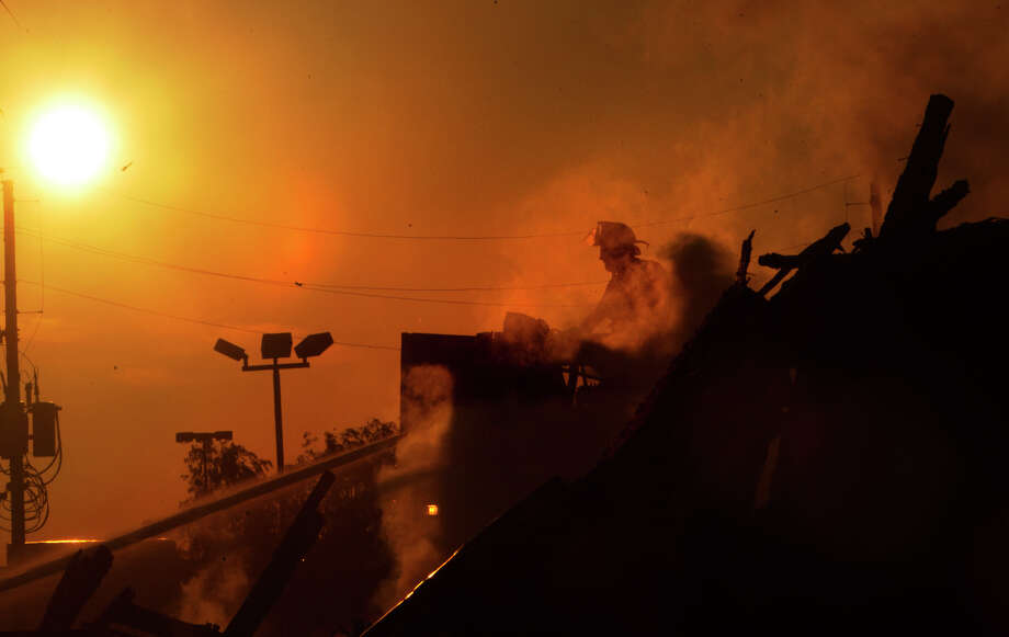 Firefighters battle a 4-alarm blaze that started in a motel under construction along Hempstead Highway near FM 1960, Tuesday, July 2, 2013, in Houston. Photo: Cody Duty, Houston Chronicle / © 2013 Houston Chronicle