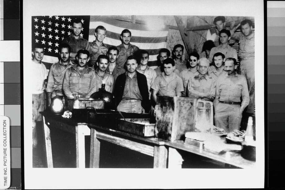 1942 -- A group of American prisoners of war pictured in front of an American flag to celebrate Independence Day in a Japanese prison camp at Casisange, Philippines, which was against Japanese regulations. Discovery could have meant death. Photo: Time Life Pictures, Getty Images / Time Life Pictures