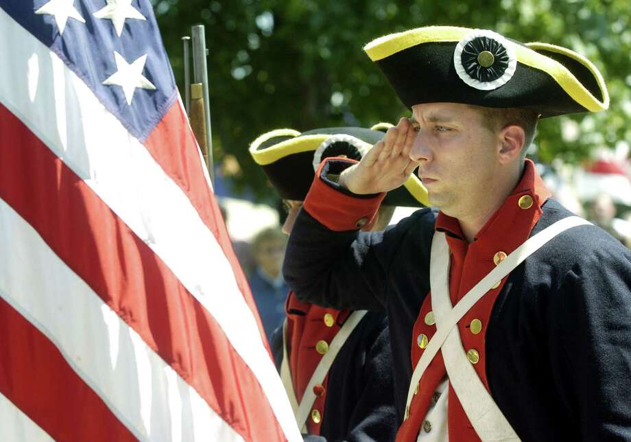 2004 -- We've since done away with hat ribbons for soldiers. Photo: Larry W. Smith, Getty Images / 2004 Getty Images