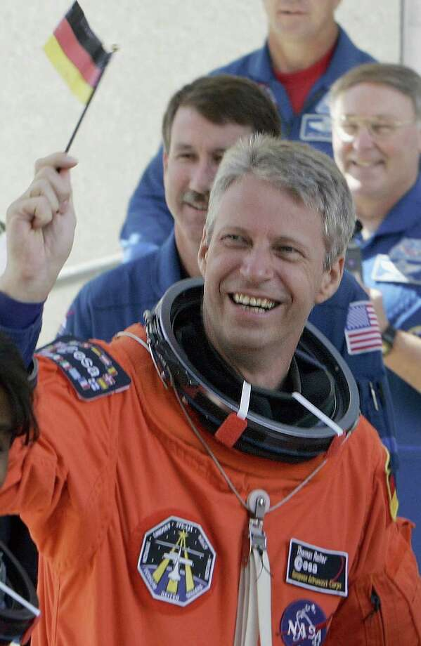 2006 -- Wrong flag, German astronaut Thomas Reiter. Also, how'd you like our ride? Photo: ROBERT SULLIVAN, Getty Images / 2006 AFP