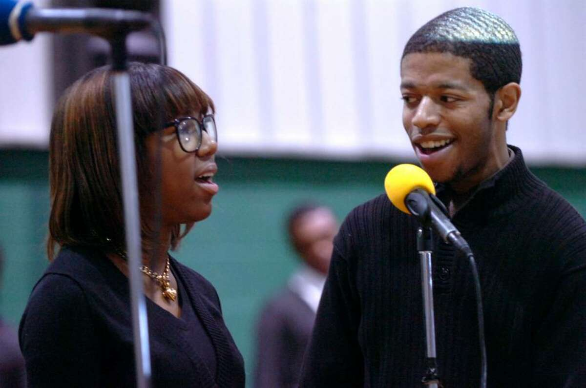Greenwich, Jan. 14, 2010. Hannah Brown and Chris Foster, of the Gospel Knights sing The Lord's Prayer at the Martin Luther King Jr. Prayer service at the Convent of the Sacred Heart.