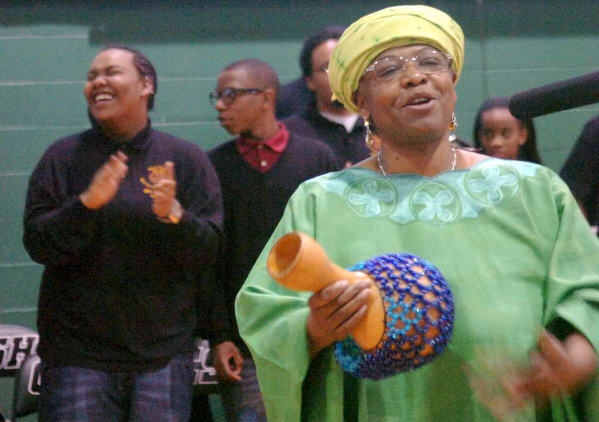 Greenwich, Jan. 14, 2010. Carole Caru Thompson, playing the beaded gourd at the Martin Luther King Jr. Prayer Service at Convent of the Sacred Heart. Behind Thompson is the Gospel Knights, the city district choir from Mr. Vernon, NY