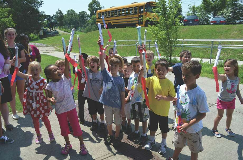 "Kindergarten and first-grade students display their model rockets, which they made at the Discovery Museum's ""Kosmic Kids"" one-week program. Weekly programs, for kindergarten through ninth grade students, will be offered through Aug. 9. Photo: Contributed Photo"