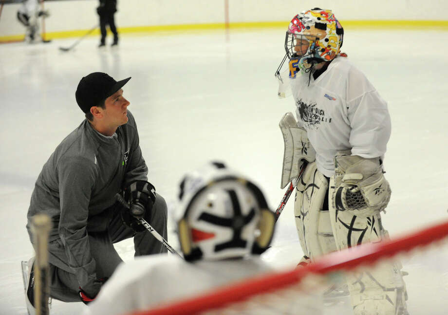 Jonathan Quick talks to Cameron Smith during the NHL's Jonathan Quick Goalie Camp at Stamford Twin Rinks on Tuesday, July 2, 2013. Quick is a goalie for the LA Kings. Photo: Jason Rearick / Stamford Advocate