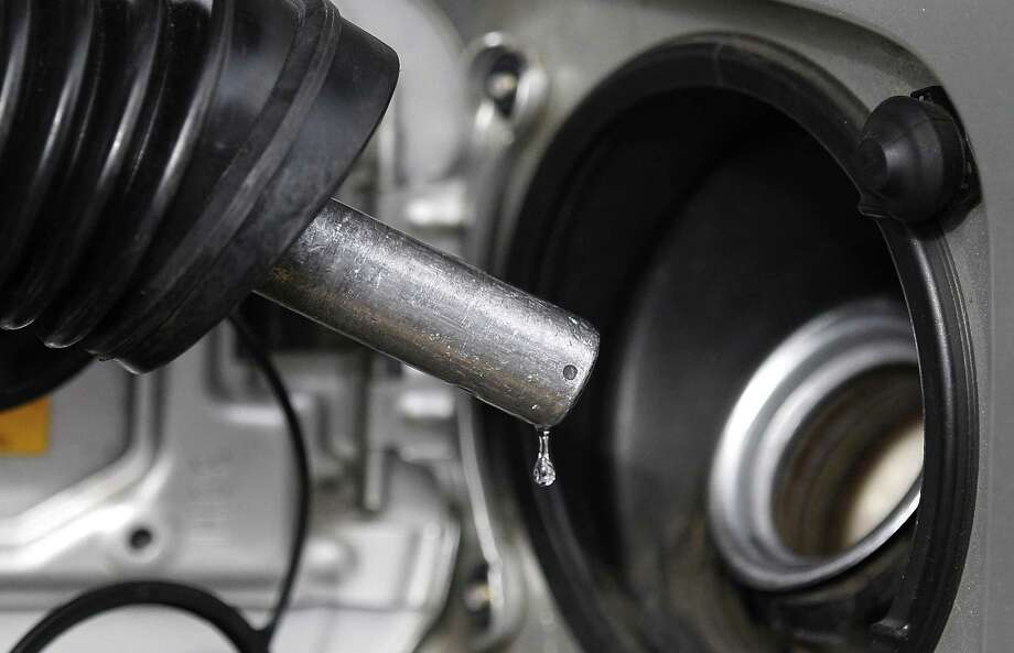 FILE - In this Thursday, Feb. 23, 2012 file photo, gasoline drips from a nozzle at gas station in Lake Oswego, Ore. The price of oil had a sudden burst Monday, June 24, 2013, after the stock market tried to put the brakes on a four-day skid. Benchmark oil for August delivery rose $1.49 to close at $95.18 a barrel on the New York Mercantile Exchange. (AP Photo/Rick Bowmer, File) Photo: Rick Bowmer, STF / AP