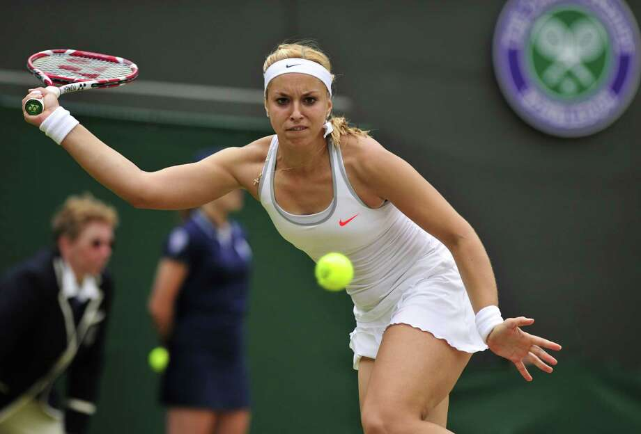 Germany's Sabine Lisicki returns against Estonia's Kaia Kanepi during their women's quarter final match on day eight of the 2013 Wimbledon Championships tennis tournament at the All England Club in Wimbledon, southwest London, on July 2, 2013. AFP PHOTO / GLYN KIRK - RESTRICTED TO EDITORIAL USEGLYN KIRK/AFP/Getty Images Photo: GLYN KIRK / AFP