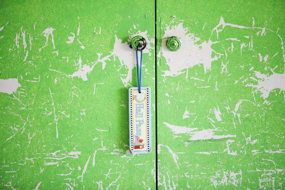A hall pass is hung on a heavily worn cabinet at North Forest ISD's Fonwood Elementary School, July 2, 2013 in Houston. Photo: Eric Kayne, For The Chronicle / ©2013 Eric Kayne