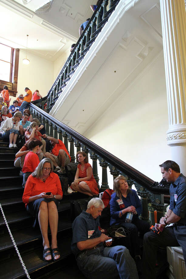 DPS troopers hang out in the hallways as supporters of both sides of the issue fill the Capitol building in Austin as a special committee hears testimony on Senate Bill 2  on July 1, 2013. Photo: Tom Reel, San Antonio Express-News