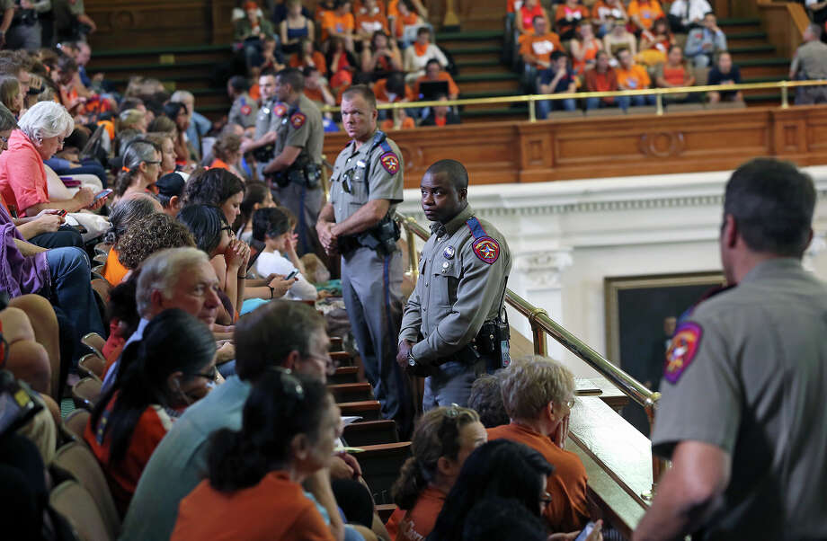 DPS officers wait in the hallways as supporters of both sides of the issue fill the Capitol building in Austin as a special committee hears testimony on Senate Bill 2  on July 1, 2013. Photo: Tom Reel, San Antonio Express-News