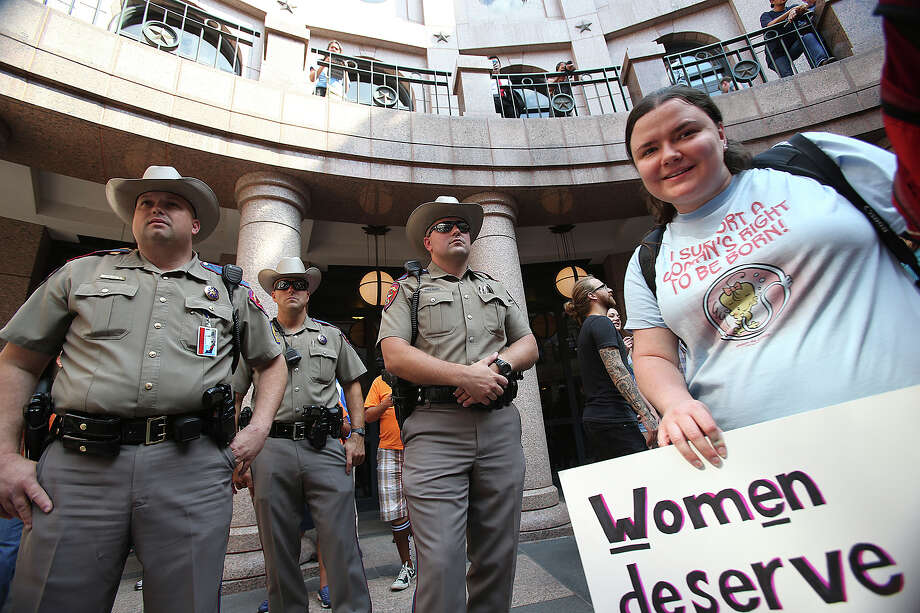 DPS officers watch the crowd as supporters of both sides of the issue fill the Capitol building in Austin as a special committee hears testimony on Senate Bill 2  on July 1, 2013. Photo: Tom Reel, San Antonio Express-News