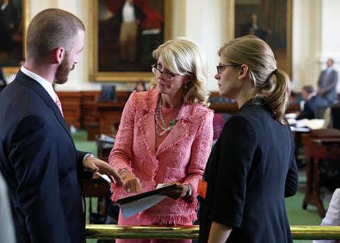 Senator Wendy Davis talks with her staff as the Senate debates passage of abortion legislation on July 12, 2013. Photo: Tom Reel, San Antonio Express-News