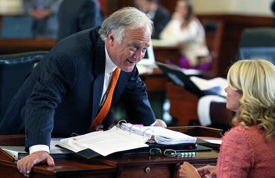 Senator Kirk Watson (D-Austin) talks with Senator Wendy Davis (D-Fort F-Worth) as the Senate debates passage of abortion legislation on July 12, 2013. Photo: Tom Reel, San Antonio Express-News