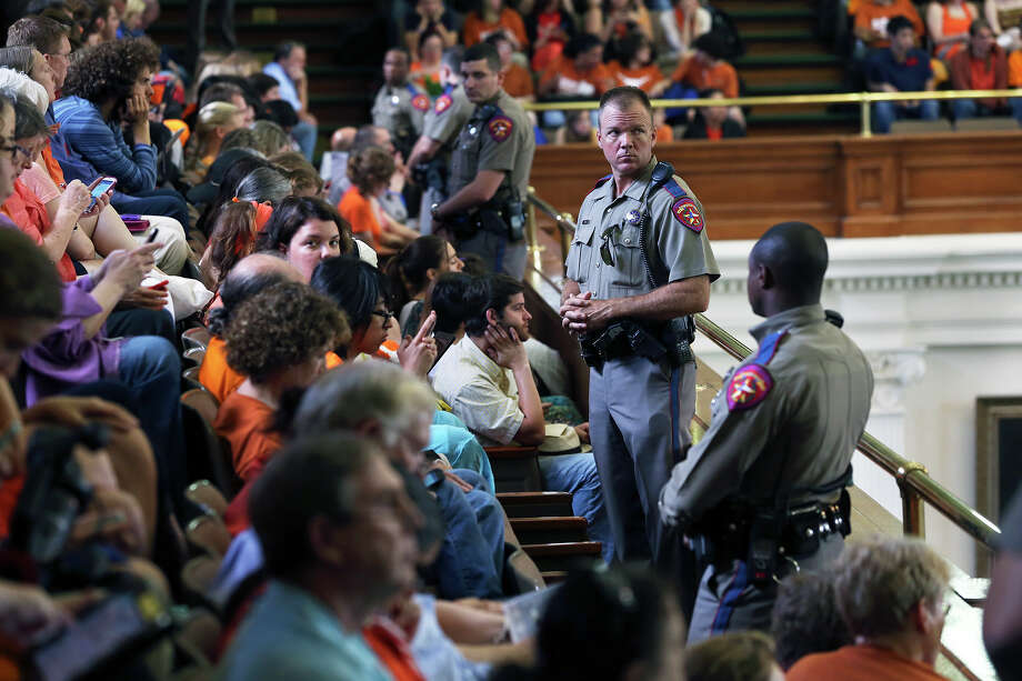 Protestors watch speakers as supporters of both sides of the issue fill the Capitol building in Austin as a special committee hears testimony on Senate Bill 2  on July 1, 2013. Photo: Tom Reel, San Antonio Express-News