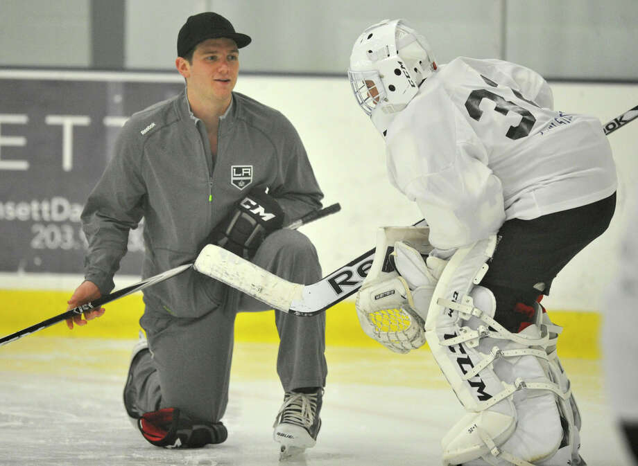 Los Angeles Kings goalie Jonathan Quick, a Hamden native, works with a student at his Goalie Camp at Stamford Twin Rinks on Tuesday, July 2, 2013. Photo: Jason Rearick / Stamford Advocate
