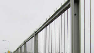According to the Washington State Department of Transportation, a suicide-prevention fence had to be put up on the Aurora Bridge because it was the second-most-popular bridge for suicides in the nation, behind the Golden Gate Bridge in San Francisco.    Photo: The fence is eight feet, nine inches tall and runs along both outer edges of the bridge for the entire length of the bridge.     Credit:  WSDOT's Flickr page .