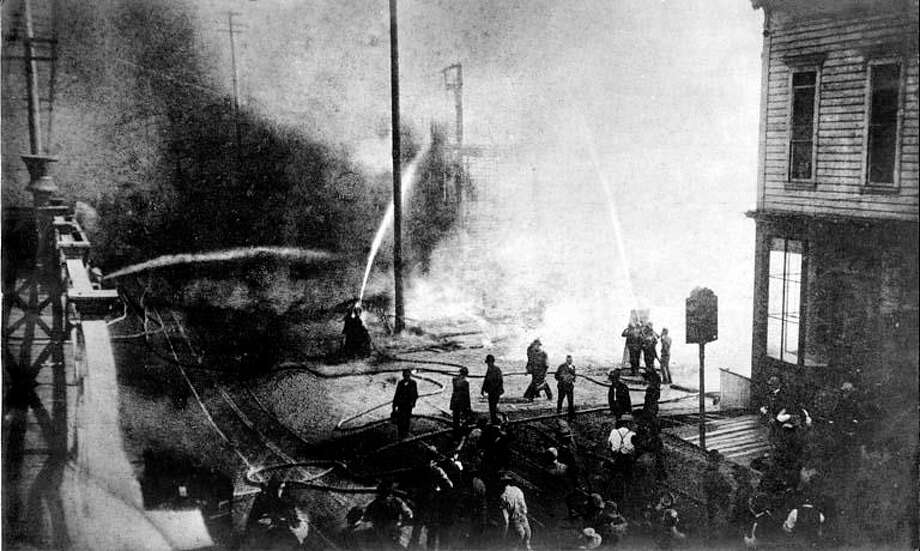 The start of the Great Seattle Fire of June 6, 1889, looking south on First Avenue near Madison Street.
