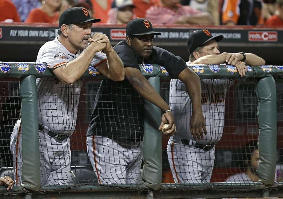 Giants manager Bruce Bochy (left) watches from the dugout as Reds pitcher Homer Bailey throws a no-hitter. The team is fourth place in the division and needs to make a move soon. Photo: Al Behrman, Associated Press
