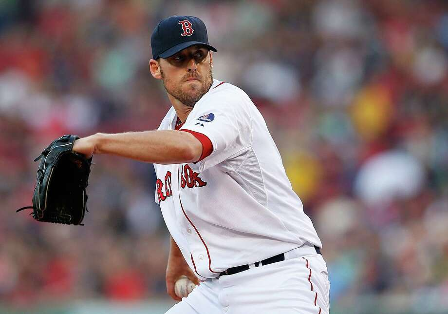 BOSTON, MA - July 2: John Lackey #41 of the Boston Red Sox throws in the 1st inning against the San Diego Padres in the 1st inning at Fenway Park on July 2, 2013 in Boston, Massachusetts.  (Photo by Jim Rogash/Getty Images) ORG XMIT: 163494376 Photo: Jim Rogash / 2013 Getty Images