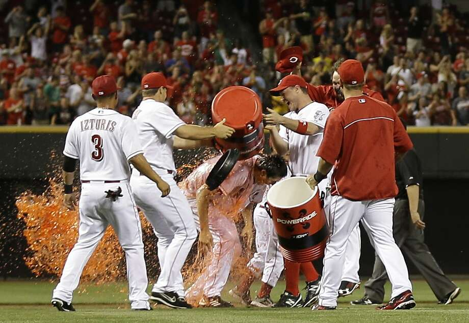 Cincinnati Reds starting pitcher Homer Bailey, center, is doused by his teammates after Bailey threw a no-hitter against the San Francisco Giants in a baseball game, Tuesday, July 2, 2013, in Cincinnati. Cincinnati won 3-0. (AP Photo/Al Behrman) Photo: Al Behrman, Associated Press