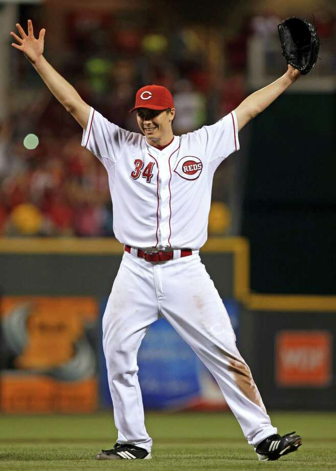 Cincinnati Reds starting pitcher Homer Bailey celebrates after pitching a no-hitter against the San Francisco Giants in a baseball game, Tuesday, July 2, 2013, in Cincinnati. Cincinnati won 3-0. (AP Photo/Al Behrman) ORG XMIT: CSA109 Photo: Al Behrman / AP