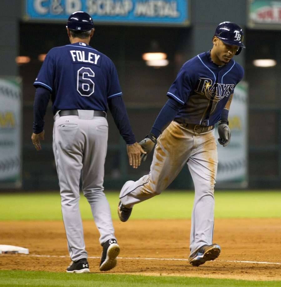 Rays center fielder Desmond Jennings runs past his third base coach Tom Foley after hitting a two-run home run off Astros relief pitcher Josh Fields during the sixth inning.